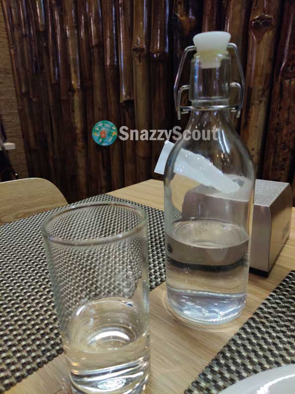Glass water bottle served during meal