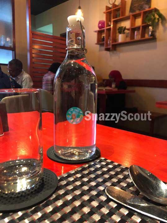 Glass water bottle served at PITA PAN